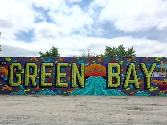 The largest mural in Green Bay on Main Street displays the highlights of the city.