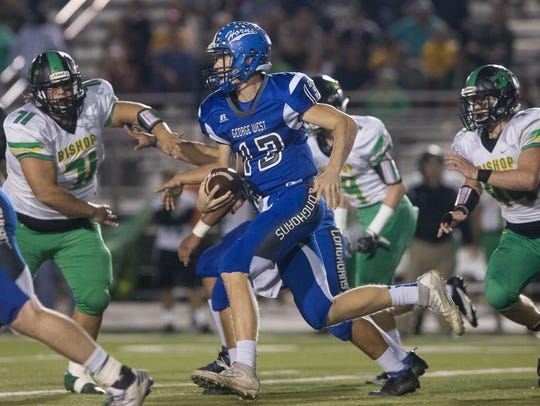 George-West's quarterback Dakota Wallek runs the ball