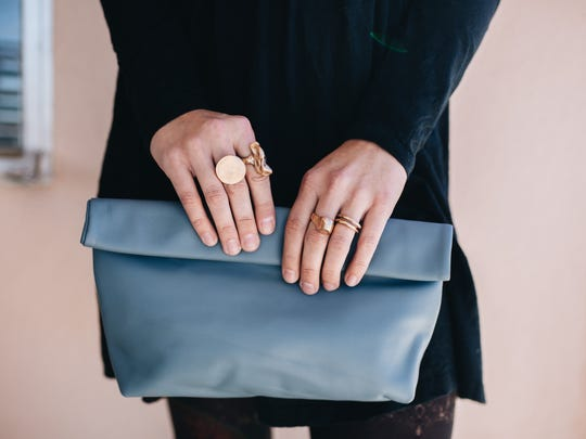 Lili T California leather clutch and rings
