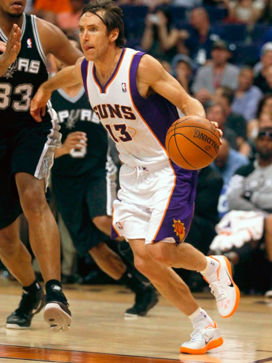 FILE- In this April 25, 2012, file photo, Phoenix Suns' Steve Nash (13) competes against the San Antonio Spurs during the second half of an NBA basketball game in Phoenix. More than 30 years later, thanks to Billy Donovan, Steph Curry, Steve Nash, the Villanova Wildcats and dozens more players, coaches and teams who re-defined what a 3 could be, shooting from beyond the arc is officially a bona fide way to chase a championship. (AP Photo/Matt York, File)