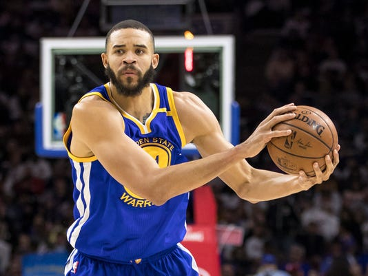 """In this Feb. 27, 2017 photo, Golden State Warriors' JaVale McGee is in action during the first half of an NBA basketball game against the Philadelphia 76ers in Philadelphia. McGee is part of """"The Others,"""" Golden State's tight-knit group of non-superstars. The backups. (AP Photo/Chris Szagola)"""