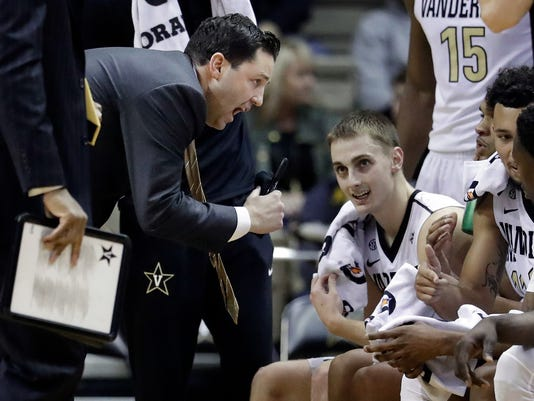 Vanderbilt head coach Bryce Drew talks to his players in the second half of an NCAA college basketball game against LSU Saturday, Jan. 20, 2018, in Nashville, Tenn. Vanderbilt won 77-71. (AP Photo/Mark Humphrey)