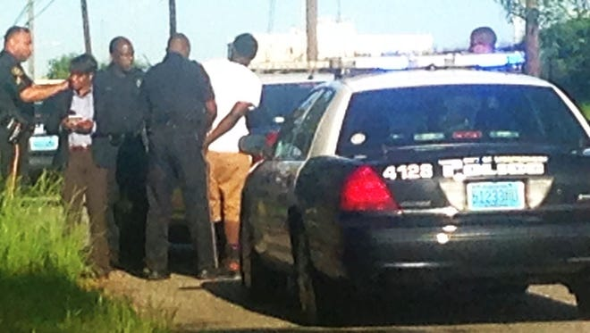 A man was seen in handcuffs at the scene of the shooting on Spruce Street.