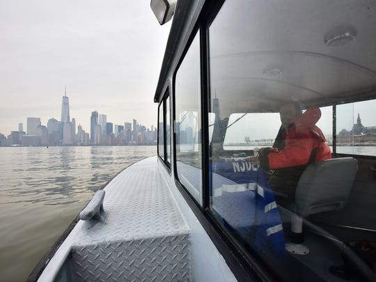 John Zuzeck, an environmental specialist with the state Department of Environmental Protection's water compliance and enforcement division, skippers the boat on the Hudson River during a patrol on Feb. 15.