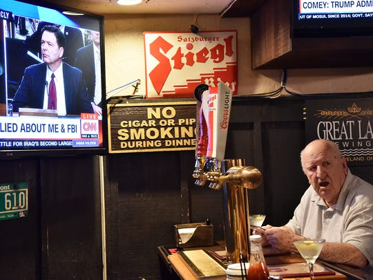 """Dick Williams, 83, a former high school physics teacher who has lived in Allendale for four decades, sipped a martini as he watched Comey's testimony at the Allendale Bar and Grill on Thursday. """"Everybody in the world is watching this thing,""""he said."""