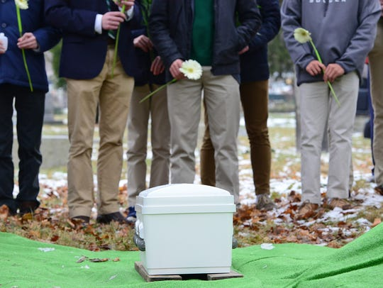Students from Delbarton School in Morristown hold a