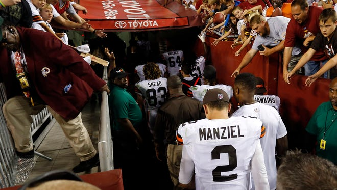 Cleveland Browns quarterback Johnny Manziel (2) walks off the field after the Browns game against the Washington Redskins at FedEx Field.