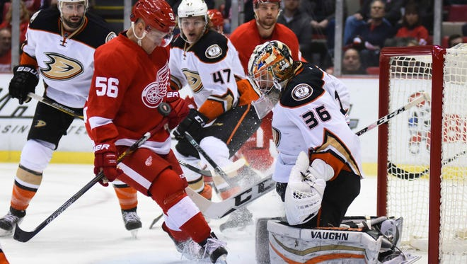 Ducks goalie John Gibson (36) makes a save against Red Wings left wing Teemu Pulkkinen (56) during the first period at Joe Louis Arena Saturday.