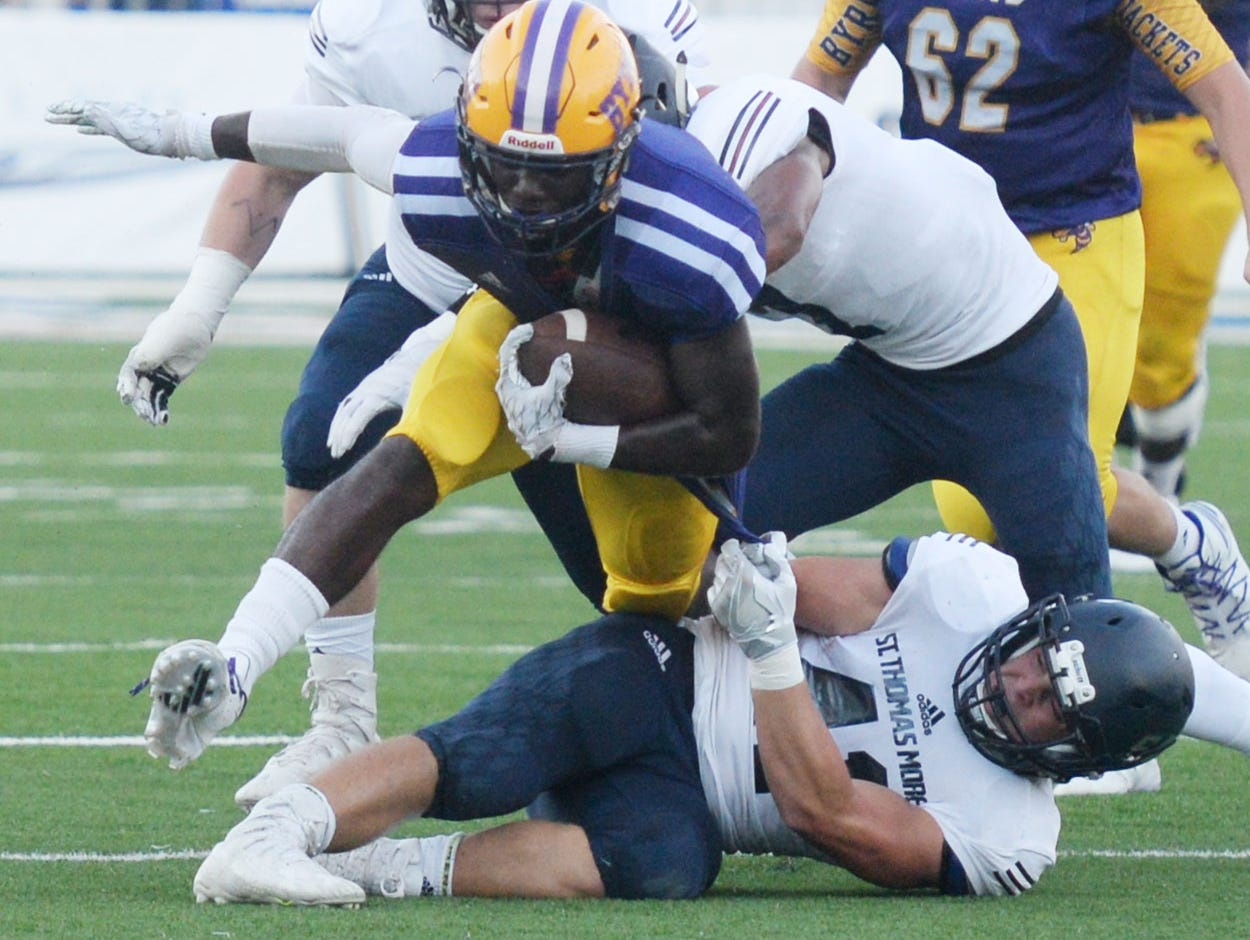 Byrd's Javien Wilson tries to get past St. Thomas More's Paul Laborde during the Battle on the Border Thursday evening at Independence Stadium.
