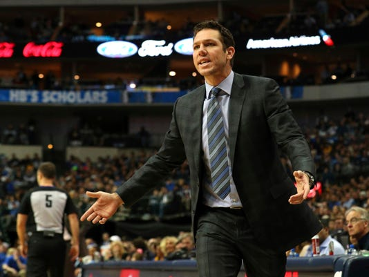 Los Angeles Lakers head coach Luke Walton reacts to a foul call during an NBA basketball game against the Dallas Mavericks, in Dallas, Saturday, Feb. 10, 2018. (AP Photo/ Richard W. Rodriguez)