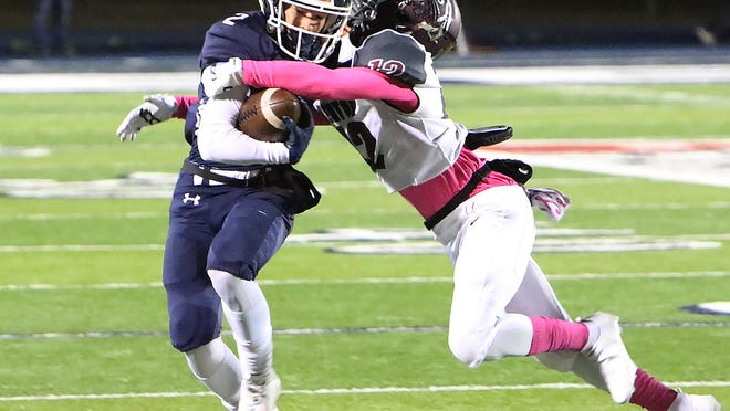 Greenwood's Jase Strozier shakes Benton's Chris Bronson for a gain in the second quarter, Friday, Oct. 23, at Smith-Robinson Stadium.