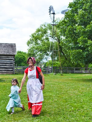 """Heritage Hill State Historical Park's Laura Ingalls Wilder Days attendees Joey Schuetz and her daughter Elisabeth (4) fit right in with the theme by wearing clothing similar to that worn in the late 1800's, the era depicted in TV show """"Little House on the Prairie"""" and the book series it was based on. July 17th, 2016."""