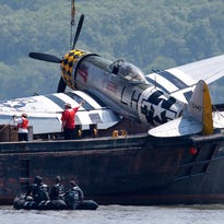 Crews operating off North Bergen, N.J., across from New York City, remove a plane out of the Hudson River on Saturday, a day after it crashed. The pilot died.