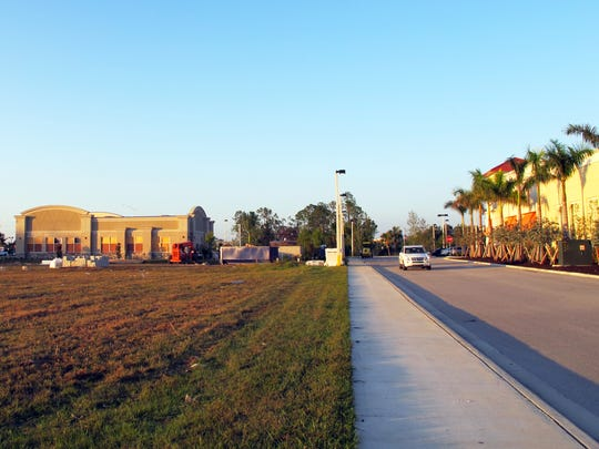 Aldi gocery store will be built on this lot, left, at the Collier Boulevard entrance to Tamiami Crossing retail center on U.S. 41 East.