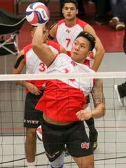 Grand View Vikings middle blocker Eric Ada slams one