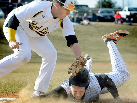 Red Lion first baseman Erik Paules tags out Northeastern's Brayton Bare on a throw from the catcher on Wednesday.