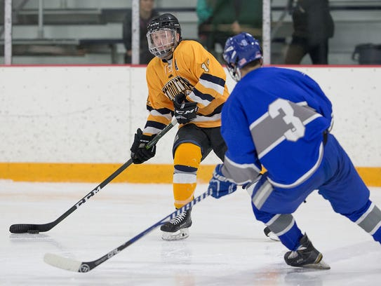 Looking to pass the puck Sunday is Schoolcraft's Vince