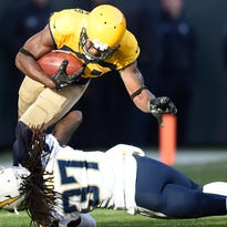 Packers wide receiver Ty Montgomery (88) injures his ankle on a tackle by Chargers strong safety Jahleel Addae (37).