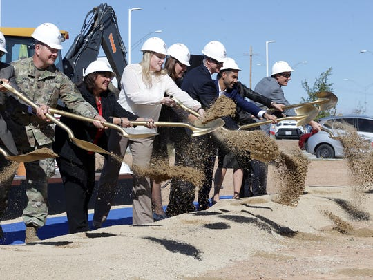 The Hospitals of Providence executives and community leaders do a ceremonial dirt shoveling Thursday at a groundbreaking ceremony for the area's second microhospital at McCombs Street and the Patriot Freeway.