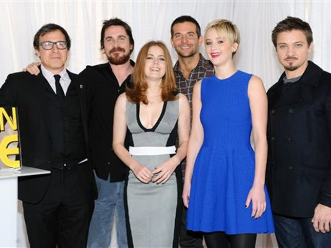 """Director David O. Russell, left, poses with the cast of """"American Hustle"""" Christian Bale, Amy Adams, Bradley Cooper, Jennifer Lawrence and Jeremy Renner pose together during a photo call at the Crosby Street Hotel on Sunday, Dec. 8, 2013 in New York. (Photo by Evan Agostini/Invision/AP)"""