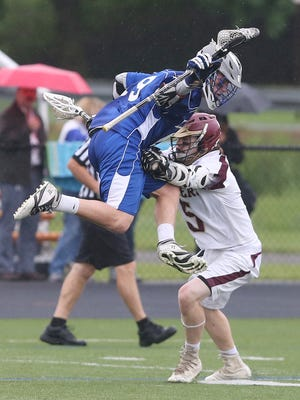 Millbrook's Alex Censi, left,  tries to avoid pressure from O'Neill's Luke Kilner during the Section 9 Class D championship game at Marlboro High School Thursday.