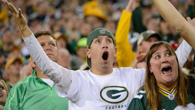 Packers fans react to a call by the referees in the second half against the Seahawks.