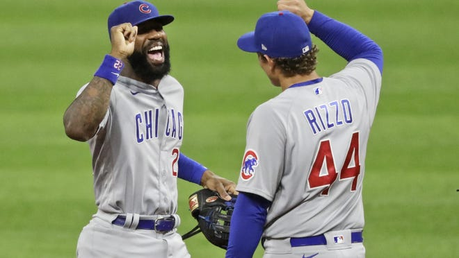 Chicago Cubs' Jason Heyward, left, is congratulated by Anthony Rizzo after the Cubs defeated the Cleveland Indians 7-1 in a baseball game, Tuesday, Aug. 11, 2020, in Cleveland.