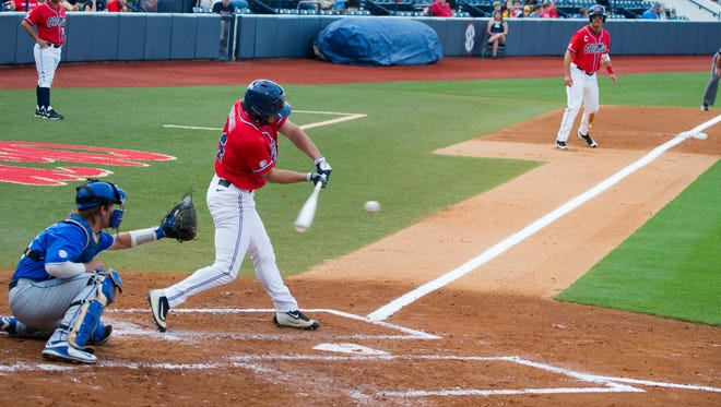 Left fielder Cameron Dishon drives in third baseman Colby Bortles in the bottom of the fourth inning. Ole Miss beat Kentucky 3-1 to open the three-game home series.