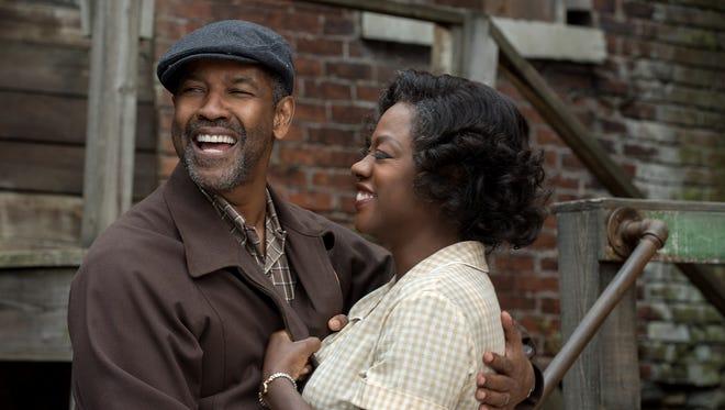 "Denzel Washington plays Troy Maxson and Viola Davis plays Rose Maxson in the movie ""Fences."""