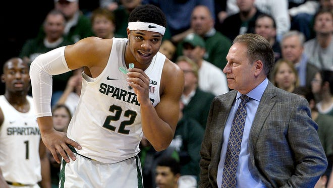 MSU freshman Miles Bridges talks with Michigan State head coach Tom Izzo during the Spartans' win over Rutgers Wednesday. Bridges, who missed the previous seven games, scored six points in 17 minutes.