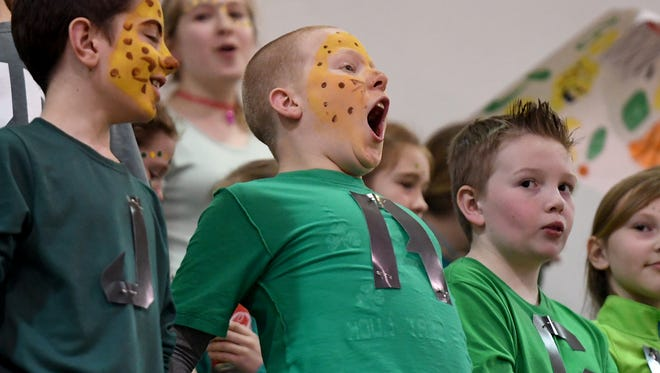 Trinity Christian Academy 5th grader Ashton Swiney lets out a roar as he cheers on the Lady Jaguars of Carroll Academy during their game against TCA, Wednesday, Feb. 7.