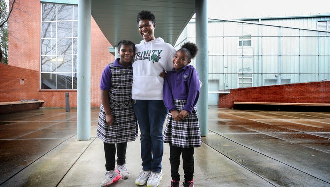 Danielle Ruffin sends her daughters, Bailey, left, and Brookelyn to St. Nicholas Academy. She is a proponent of private school tuition tax credit program being proposed in Frankfort. January 22, 2018