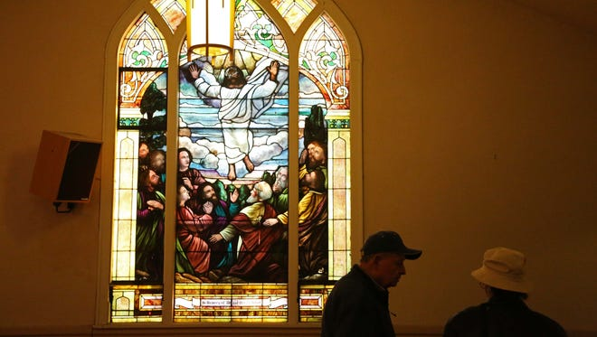 A group of people tour the former Burns United Methodist Church on Thursday, Jan. 14, 2015 in Des Moines. Community members toured the building before its demolition.