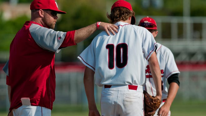 Port Huron coach Kyle Sheppard talks with players on the mound during a baseball game Tuesday, May 26, 2015 at Port Huron High School.