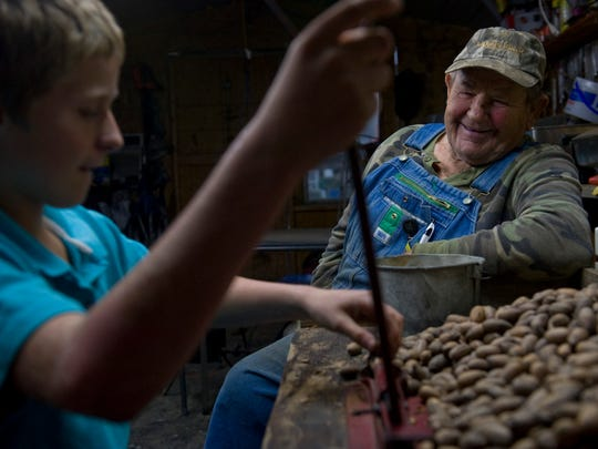 """""""You want to crack a few pecans?"""" Pee Wee Clifford asked his great grandson when he arrived after school. """"Yep,"""" Colton Hansborough, 12, answered. """"You just hammer 'em down, baby,"""" Clifford told him."""