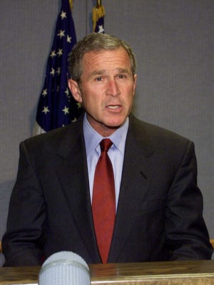 President Bush addresses the nation from Barksdale Air Force Base, La., about the terrorist acts at the World Trade Center and the Pentagon, Tuesday, Sept. 11, 2001.
