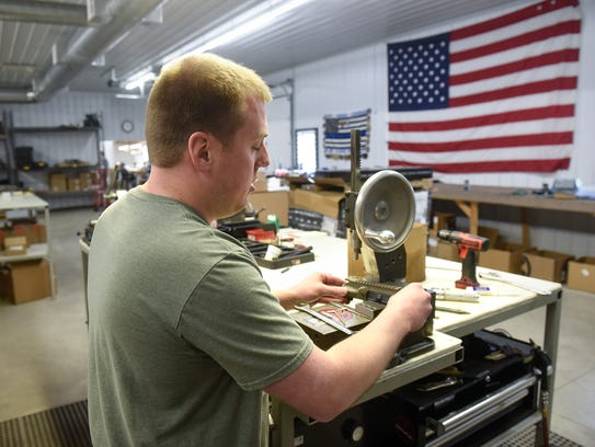 Jason Leigh demonstrates the process of assembling