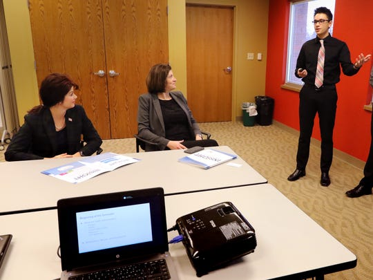 Kolton Ostermann, Patrick Cullen (right) and two other project team members make a presentation to Lt. Gov. Rebecca (left) and Pewaukee School District Chief Academic Officer Danielle Bosanec at the District's Insight workspace on Jan. 10. Their Insight team's task was to design a trade show booth for Karate America through a variety of professional contacts and meetings.