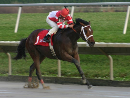 Mario Pino splashes to an easy victory aboard Hard Spun in the Port Penn Stakes at Delaware Park on Nov. 14, 2006. He would go on to ride Hard Spun to second place in the Kentucky Derby the following May.