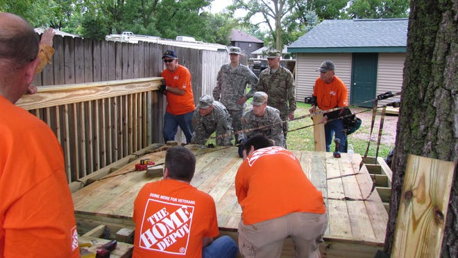 Associates from the local The Home Depot and members of the National Guard and Buckley Baldwin Veteran of Foreign Wars Post #2534 built and installed a wheelchair ramp Saturday at the home of veteran Don Brehmer of Wisconsin Rapids.