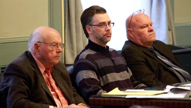 Shawn Grate sits with his attorneys Robert and Rolf Whitney at the defendants table as the second week of jury selection began on Monday, April 16.
