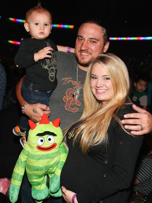 Chris Carney, who died in a car accident Dec.4, 2015 in Arkansas, with wife Tiffany Thornton and one of their children, Kenneth James, on Nov. 30, 2013.