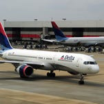 A Delta Airlines jets arrives at Atlanta-Hartsfield International Airport in Atlanta , Georgia on September 12, 2009.