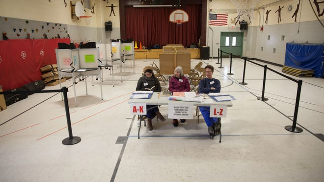 Waiting for voters at about 1 p.m. in Burlington at the Ward 2 polling location at H.O. Wheeler School.