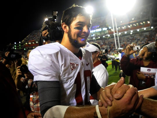 Alabama quarterback AJ McCarron (10) celebrates with fans at the end of the the Iron Bowl Saturday, Nov. 26, 2011, at Jordan-Hare Stadium in Auburn, Ala. The Tide won 42-14. (Montgomery Advertiser, Julie Bennett)