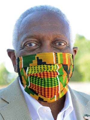 Fort Smith Mayor George McGill is seen June 14, 2020, at a Fort Smith event wearing a type of mask that a study shows to be the most effective at helping slow the spread of the coronavirus.