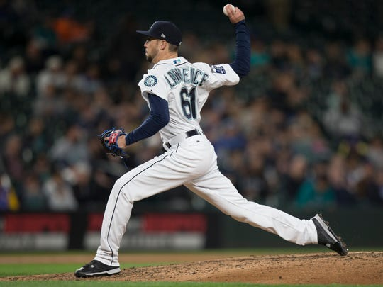 After spending seven seasons in the minor leagues, Casey Lawrence got his first chance in the MLB this season. He's pictured here pitching for the Seattle Mariners in a game against the Chicago White Sox in May.