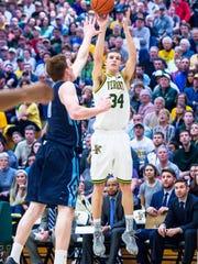 The University of Vermont's Kurt Steidl shoots over