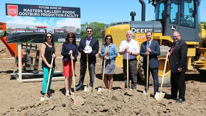 State, local and Master Gallery Foods officials pose Wednesday June 7, 2017 in Oostburg, Wis. at a groundbreaking for a new production facility for increased production of cheese products. From Left: Trina Stephens, Lt. Governor. Rebecca Kleefisch, President and CEO Jeff Gentine, Tracey Dorsey, Oostburg Village President Allen Wrubbel, State Senator Devin LeMahieu and State Representative Terry Katsma.