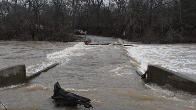 One of the biggest dangers area residents will face in the storms expected across the Twin Lakes Area this weekend are flooded roads as in this file shot last year from Marion County.